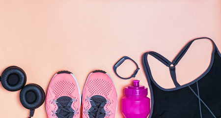 Fitness clothes and accessories on bright background