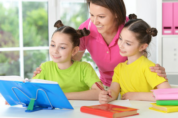 girls  with mother on lesson of art