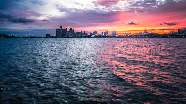 Sunset Over Detroit Michigan Skyline. Scenic sunset over the downtown waterfront cityscape of Detroit Michigan as seen from Sunset Point in Belle Isle State Park.