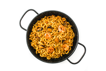 Traditional Spanish fideua. Noodle paella isolated on white background. Top view