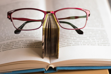Image of books and glasses. Concept: greeting card for Teacher's Day.