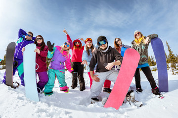 Happy friends skiers and snowboarders fun