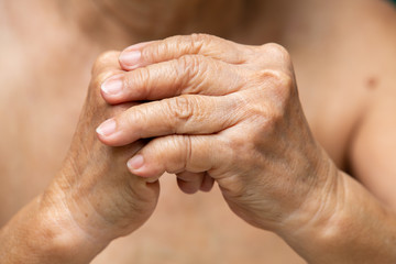 Senior woman's hands praying, Close up, Body language feeling