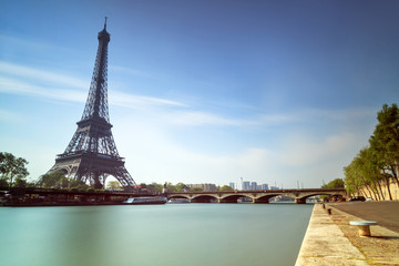 Long exposure of the Eiffel tower at the Seine in Paris in spring