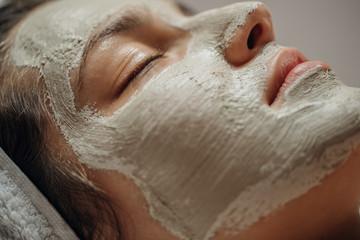 Beautiful Woman with a Facial Mask