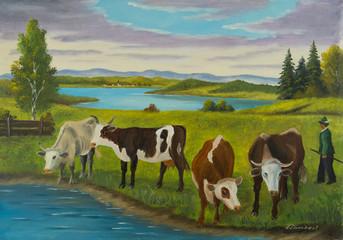 Mehrere Kühe stehen am Wasser zum trinken