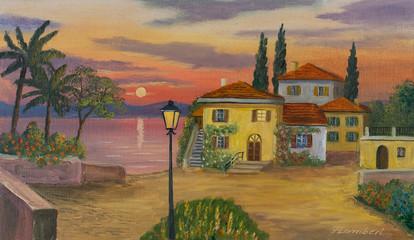 Haus am See mit schwarzer Laterne im Vordergrund