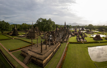 Aerial View of a historical sites ruins Buddhist Temple Wat Mahathat at The Sukhothai Historical Park, a registered UNESCO World Heritage City in the tranquil late afternoon sun