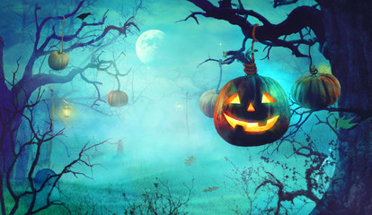 Halloween theme with pumpkins and dark forest. Spooky Halloween