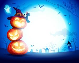 Halloween Pumpkin Pile. Stacked pumpkins in the moonlight. Jack O Lantern.