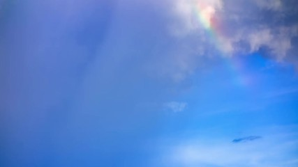 Fototapete - Time lapse rainbow revealed after rain clouds 4k.