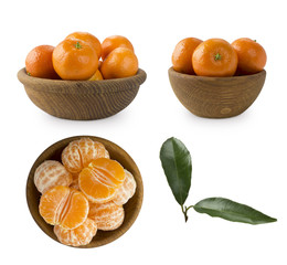 Set of frwsh tangerines isolated on white. Mandarins in a wooden bowl with copy space for text. Ripe and tasty tangerines isolated on white background. Clementines on a white background.