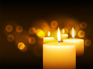 burning candles with gold bokeh