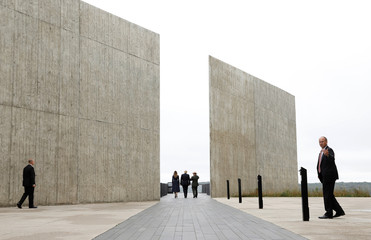 U.S. President Trump and Melania Trump walk at the Flight 93 National Memorial near Shanksville, Pennsylvania