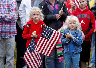 Children hold U.S. flags during the 17th annual September 11 observance at the Flight 93 National Memorial near Shanksville, Pennsylvania