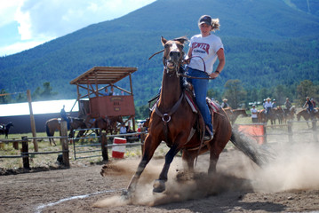 Girl Turns Horse at Dusty Rodeo