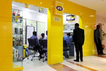 Customers are pictured inside an MTN dealer shop in Abuja