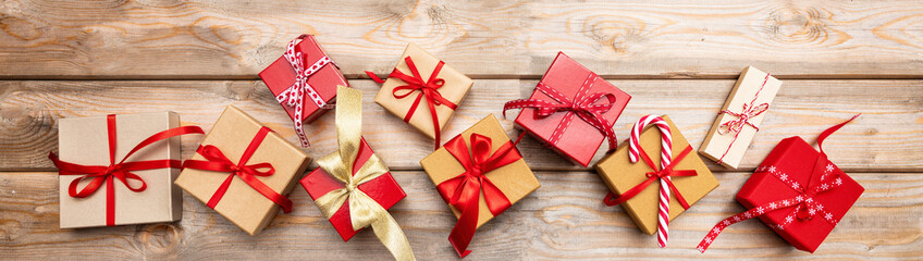 Christmas gift boxes on wooden background, banner, top view