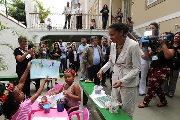 Presidential candidate Marina Silva of the Brazilian Sustainability Network Party receives a drawing from a child at the NGO Saude Crianca in Rio de Janeiro