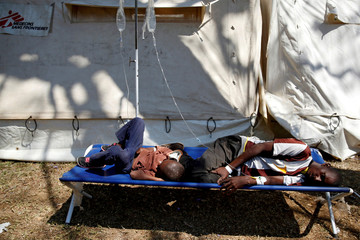 Patients await treatment at a makeshift cholera clinic in Harare