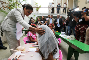 Presidential candidate Marina Silva of the Brazilian Sustainability Network Party talks to a child at the NGO Saude Crianca in Rio de Janeiro