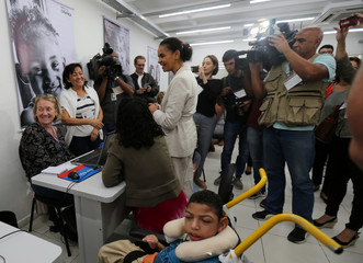 Presidential candidate Marina Silva of the Brazilian Sustainability Network Party talks with volunteers at the NGO Saude Crianca in Rio de Janeiro