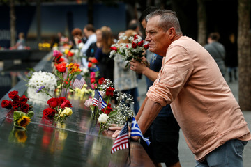 Guests visits the National 9/11 Memorial during ceremonies marking the 17th anniversary of the September 11, 2001 attacks on the World Trade Center, at the National 9/11 Memorial and Museum in New York