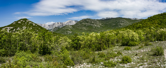 "Landscape rocky mountains national park ""Paklenica"" in Croatia. Peaks of rocky hills with occasionally vegetation."