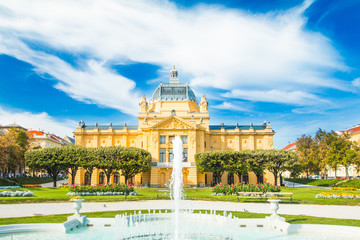 Zagreb, Croatia, art pavilion and beautiful flowers in park in summer day, colorful 19 century architecture