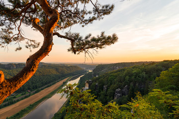 Landscapes of Saxon Switzerland - is the German part of Elbe Sandstone Mountains. Sunset over the valley of the river Elbe.