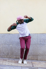 Young man dancing to music in the street