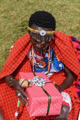 Maasai man holding a gift box