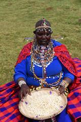 Maasai woman sorting corn