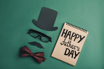 Flat lay composition with bow tie and paper decor on color background. Happy Father's Day