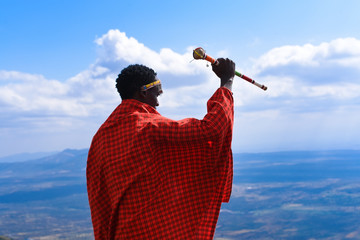 Maasai man holding beaded stick