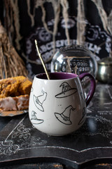 Witches hat mug drink in spooky Halloween setting