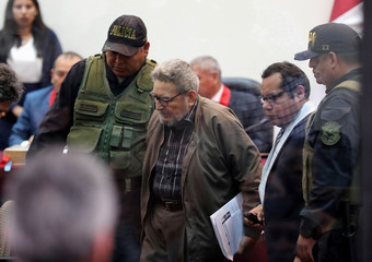 Shining Path founder Abimael Guzman attends a trial during sentence of a 1992 Shining Path car bomb case in Miraflores, at a high security naval prison in Callao