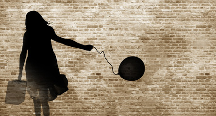 Shadow on a wall of a refugee girl with her suitcase and a balloon