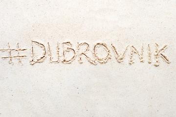 "Handwriting words ""Dubrovnik"" on sand"
