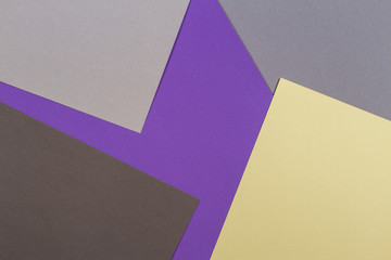Abstract geometric paper texture cardboard background. Top view of purple violet yellow gray trendy colors tones