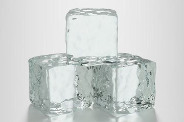 Three ice cubes on clean surface