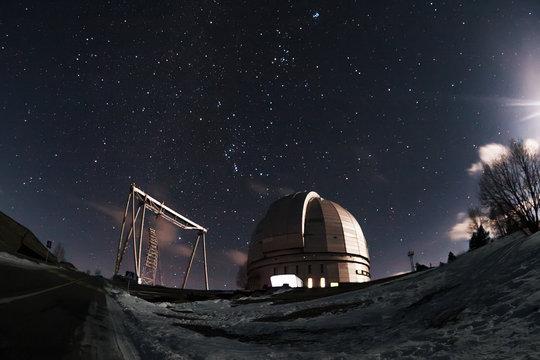 The view of the telescope BTA on a dark background of a starry sky. Arkhyz. Night astrophotography. Karachay-Cherkessia. SAO RAS.