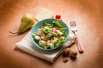 salad with cheese pear radish lettuce and nuts