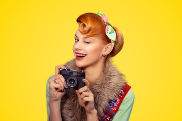 Photographer. Woman smiling, holding camera.