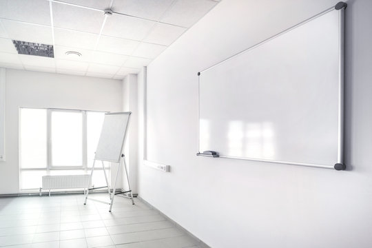 Empty presentation room with whiteboard.