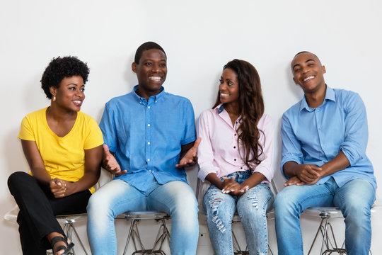 Talking african american group of people in waiting room