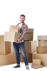Young man with cardboard boxes on white background