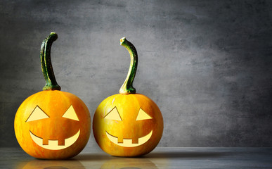 Scary Halloween pumpkins isolated on a black background. Scary smiling faces trick or treat.