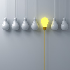 Think different concept One glowing light bulb standing out from the dim or unlit white lightbulbs on white wall background with shadows leadership and individuality creative idea concept 3D rendering