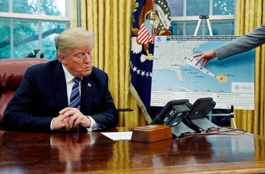 President Trump holds a meeting on hurricane preparations in the Oval Office of the White House in Washington